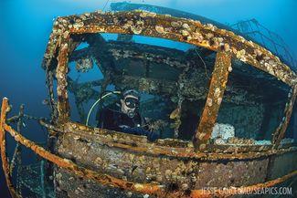 A diver explores inside the Oriskany
