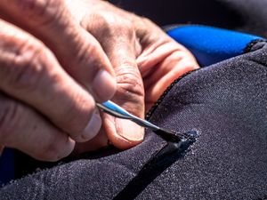 how to fix a wetsuit tear