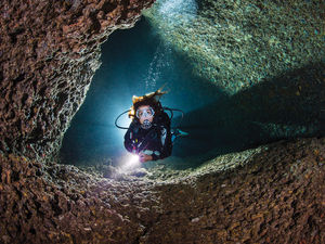 underwater photo of a diver in Italy